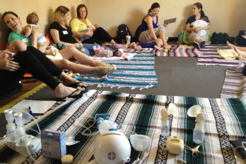 Moms Learning About Breastfeeding at A Babymoon Inn Back To Work Class for new moms