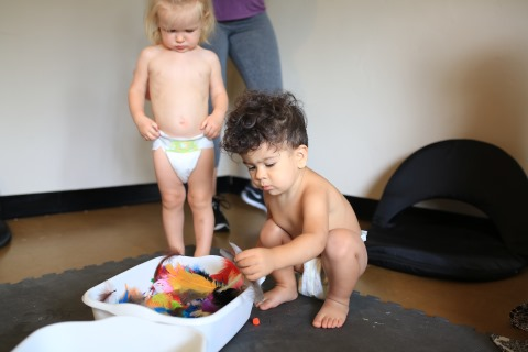 children enjoying sensory play at a babymood whole family birth class at Baby Moon In near Down Town Phoenix Valley